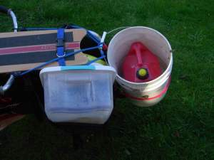 gallon of gas in a bucket on xtracycle